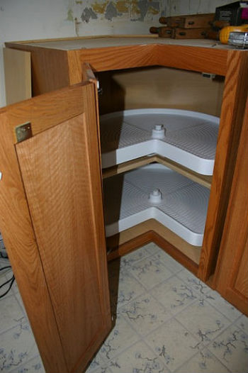 lazy susan in kitchen cabinet eliminate dead space in your kitchen cabinet addons 22551
